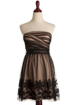 The dress...black with a flesh coloured underskirt - I love the frill and the cross over bodice!