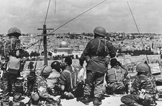 Mordechai 'Motta' Gur (seated, with black curly hair) and his troops survey the Old City before launching their attack, May 1967. (photo credit: Wikimedia Commons CC BY-SA/Mazel123) via Times of israel interview with Yossi ha Levi