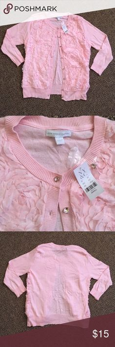 New York & Company Cardigan Girly and Fun is how to describe this never been worn cardigan! Tags still on and even has the extra button. New York & Company Sweaters Cardigans