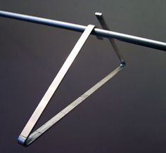 18 Modern Clothes Hanger Designs toxel.com