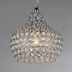 Add some elegance to your home with the Kiss crystal chandelier. This dynamic lighting element features generous rows of cascading crystals to catch the light.