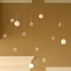 """For a unique decorative idea, create faux """"floating bubbles"""" by hanging small Styrofoam balls and glass bubbles (with hanging hole) from transparent thread or fishing wire.    This could be fun in the """"bedrooom"""" dorm!"""