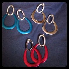 SET OF 3 EARRINGS NEVER WORN Beautiful set of light weight earrings in 3 colors, Turquoise, Silver, and Fuchsia. Never worn in Excellent Condition Jewelry Earrings