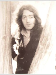 Rory Gallagher. The shot is a little out of focus, but I've never seen this one before.