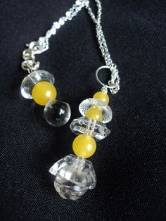 Vintage glass beads and buttons on silver chain