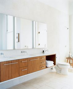 the master bathroom used to be a tiny kitchen in what was once a tiny apartment the cabinets were designed by nilus de matran and fabricated by george