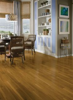 Laminate is the perfect choice for high traffic areas. It's long lasting good looks are low maintenance and compliment any decor.  https://www.barronsflooring.com
