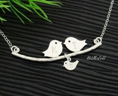 Parents and baby bird Necklace, Bird Family Necklace. Mom dad and child Monogram, SILVER bird initial necklace, Mother day's gift. $32.00, via Etsy.