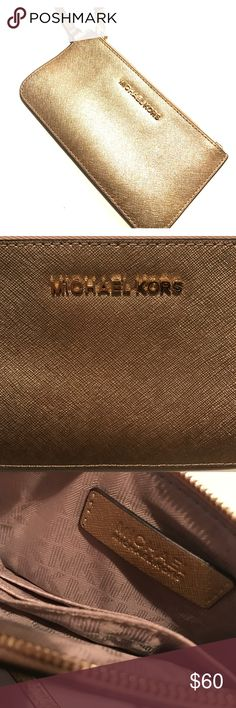Michael Kors Wristlet This gold Michael Kors wristlet, in perfect condition (never used), is perfect for a night out, special occasion, or even a trip to the grocery store! Michael Kors Bags Clutches & Wristlets