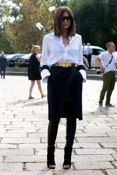 How to Layer a Skirt Over Pants or a Dress - crisp white button down shirt tucked into a black pencil skirt + layered over leather pants
