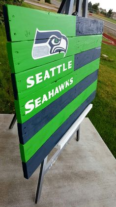 40 x 25 in. Pallet wood, hand painted, wax sealed. Seattle Seahawks wood Flag, green and blue. https://m.facebook.com/Momasparkles