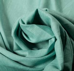 Cotton Linen Blend Blue Fabric, 142cm, £9/m, Strong cotton linen in a bright turquoise blue. Light-weight and slightly sheer, with no stretch; ideal for casual shirts and summer trousers. Do not bleach. Machine wash, warm iron, tumble dry low.