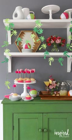 Party in Paradise - DIY Palm Tree Garland, Pineapple Cupcakes with Coconut Cream Cheese Frosting, and Spicy Chipotle Pineapple Martinis Holiday Party Themes, Holiday Parties, Paper Palm Tree, Pineapple Cupcakes, Aloha Party, Beach Party, Inspired By Charm, Party Props, Party Ideas