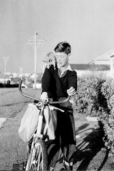A newspaper delivery round was one of the ways that boys earned money in the century, when this photograph of Peter Williams on his delivery round was taken. Accompanying him is his pet possum. Newspaper Delivery, Local History, Animal Pictures, New Zealand, Dads, Couple Photos, Image, Photography, Couple Pics