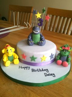 Barney the Dinosaur sponge birthday cake for a little girl's 3rd birthday. Also shows his fondant friends BJ and Baby Bop