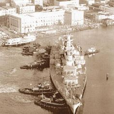 """USS North Carolina being """"tugged"""" into her present position as a Museum ship."""