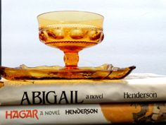 I own two of these which I enjoy just looking at! Amber Glass Pressed Goblet Dessert cup and by RetroJerky.