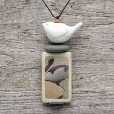 Ceramic bird necklace,mixed media art to wear,zen, meditative. $52.00, via Etsy.