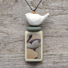 Ceramic bird necklace,mixed media art to wear,zen, meditative. $52.00, via Etsy.