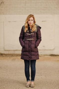 20 outfits that show puffer coats CAN be stylish - plum puffer coat with cuffed skinny jeans and flats