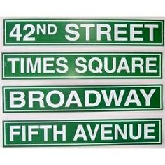 New York Street Signs atop tables for centerpieces or....other tables