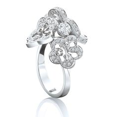 Inspired by the lightness and delicacy of a sun-dappled spring morning, this @boodlesuk Blossom cluster ring features a stylised floral motif, with petals that sparkle with diamond dewdrops #Boodles #luxury #jewelry #diamonds #flowers