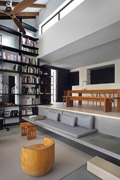Tall bookshelves with split-level space.  Example of a good transition.