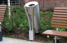 Stainless steel circular post mounted litter bin mounted on twin tubular steel post.