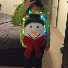 Ugly yet adorable Xmas / Christmas sweater! Super cute colorful ugly Xmas sweater that lights up.  The snow man is knitted in place, please do not try to wash this sweater, it has already been washed prior to decorating and only worn once after for pics.  The lights is battery operated!!! And the switch to turn on and off is tucked behind the bow. Handmade Sweaters Crew & Scoop Necks