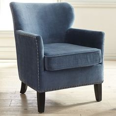 Everybody loves Lyndon. Inspired by a Paris flea market find, our classic easy chair is covered in luxurious textured velvet, has a comfy wraparound wingback, high padded armrests and a sturdy hardwood frame. Traditional extended seat cushion supplies added leg support. Distinctive nailhead trim completes this great find.