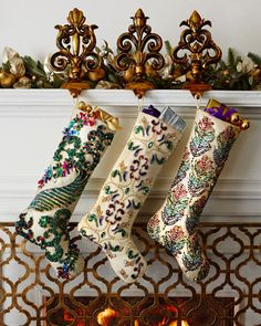 Sugarplum Christmas Stockings by Kim Seybert at Horchow.  Embroidery and Color Inspiration .. have feather embroidery designs that look like stocking on right.