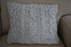 Easy Cable knit pillow cover with button fastenings.
