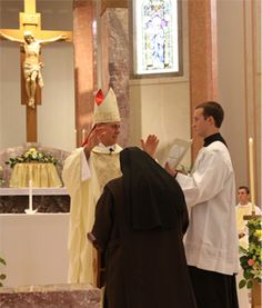 Bishop gives Sr Gianna Marie the Blessing of Consecration.