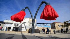 """These Flower Lamps Bloom When People Stand Under Them. Pedestrians in Jerusalem's Vallero Square can stop for some respite under these self-inflating, giant flowers. Installed by HQ Architects in 2014 and titled """"Warde,"""" these nine by nine meter flowers """"bloom"""" when someone approaches..."""