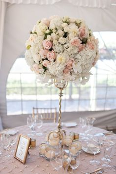 gorgeous tall pink white and gold floral centerpiece and framed table number