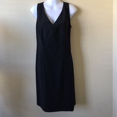 NWT Ann Taylor sexy black dress! Sexy, V-neck little black dress from Ann Taylor ! Never been worn!! New with tags!!! Ann Taylor Dresses