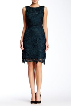 """Floral lace is crafted into a scalloped midi silhouette with an exposed zip closure. - Crew neck - Sleeveless - Exposed back zip closure - Lined - Approx. 38"""" length - Imported Fiber Content: Self: 100% polyester Lining: 100% polyester Care: Hand wash cold Additional Info: Fit: this style fits true to size."""