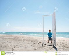 Young Boy Entering Door On Beach - Download From Over 44 Million High Quality…