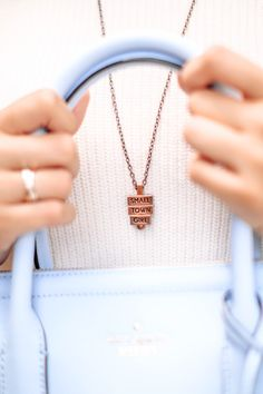 Baby blue handbag and Small Town Girl necklace from 212 west, perfectly paired
