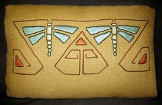 Abstracted embroidery on a pillow, available as a kit from Arts & Crafts Period Textiles.