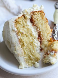 White Chocolate Cake is soft with a tender crumb & white chocolate flavor. An extra layer of strawberry preserves is sandwiched in between! #cake #chocolate