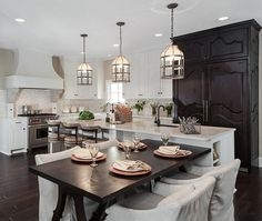 Get inspired by Modern Farmhouse Kitchen Design photo by Beckwith Interiors. Wayfair lets you find the designer products in the photo and get ideas from thousands of other Modern Farmhouse Kitchen Design photos. New Kitchen, Kitchen Dining, Kitchen Decor, Dining Area, Eclectic Kitchen, Kitchen Ideas, Armoire In Kitchen, Dining Rooms, Kitchen Island Table