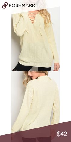 New Arrival Cream Sweater Long sleeve chunky knit sweater that features lace up details and a mock neckline.  Fabric Content: 65% acrylic 20% polyester 15% nylon. Sweaters