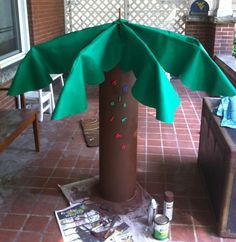 Palm tree made from a cardboard tube, umbrella, and felt!