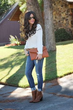 White button up with rolled up jeans and ankle boots