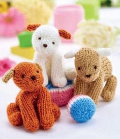 Free Knitting Pattern for Easy Puppy Trio - Small dog toy softies designed by Sachiyo Ishii. Great stash buster!