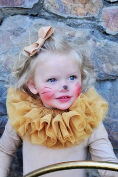 Cute lion / lioness costume with tulle neck detail and the most aforable bow in her hair More