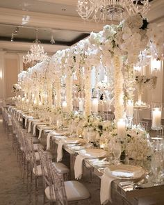 Long Luxe Table, Tall White Floral Centerpieces with Candles & Orbs | Photo: Perez Photography.