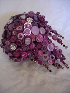 A button wedding bouquet. I like this because flowers die and this way you can keep it forever.