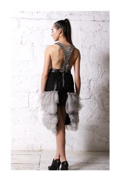 Dress floors - made from strips of sky cloth, tulle fabric and chains.The Dress design influenced by elements from the Baroque architecture with Gothic and Punk elements. Back view.